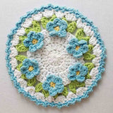 Light blue flower doily