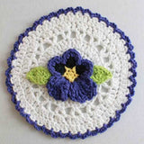 White and Purple dishcloth with pansy in the middle
