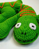 green and orange lizard pillow