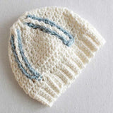 white doll hat with blue stripes