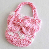 pink and white purse
