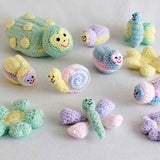 various crochet bugs and flowers