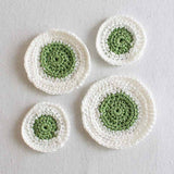 white and green saucers