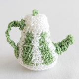 white and green tea pot