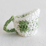 white and green creamer cup