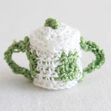 white and green sugar bowl