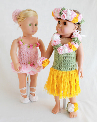 Two dolls with Hawaiian outfits