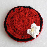 red plate with white flower
