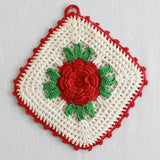 white potholder with red rose