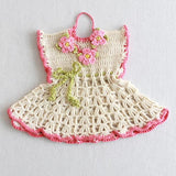 pink and white dress potholder