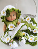 Pink and green baby doll outfit with flowers and afghan