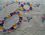 variegated rose and pansy doilies