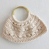 cream colored purse