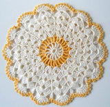 yellow and white shells in the round potholder