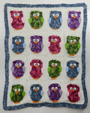 afghan with red green purple and blue owl
