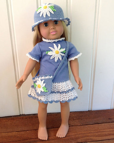 blue and white daisy t-shirt dress on doll with matching hat and purse
