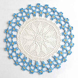 Light blue and white doily