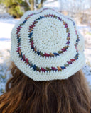 white hat with colorful stripes