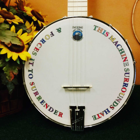 "This Machine Surrounds Hate and Forces It to Surrender"" banjo head"