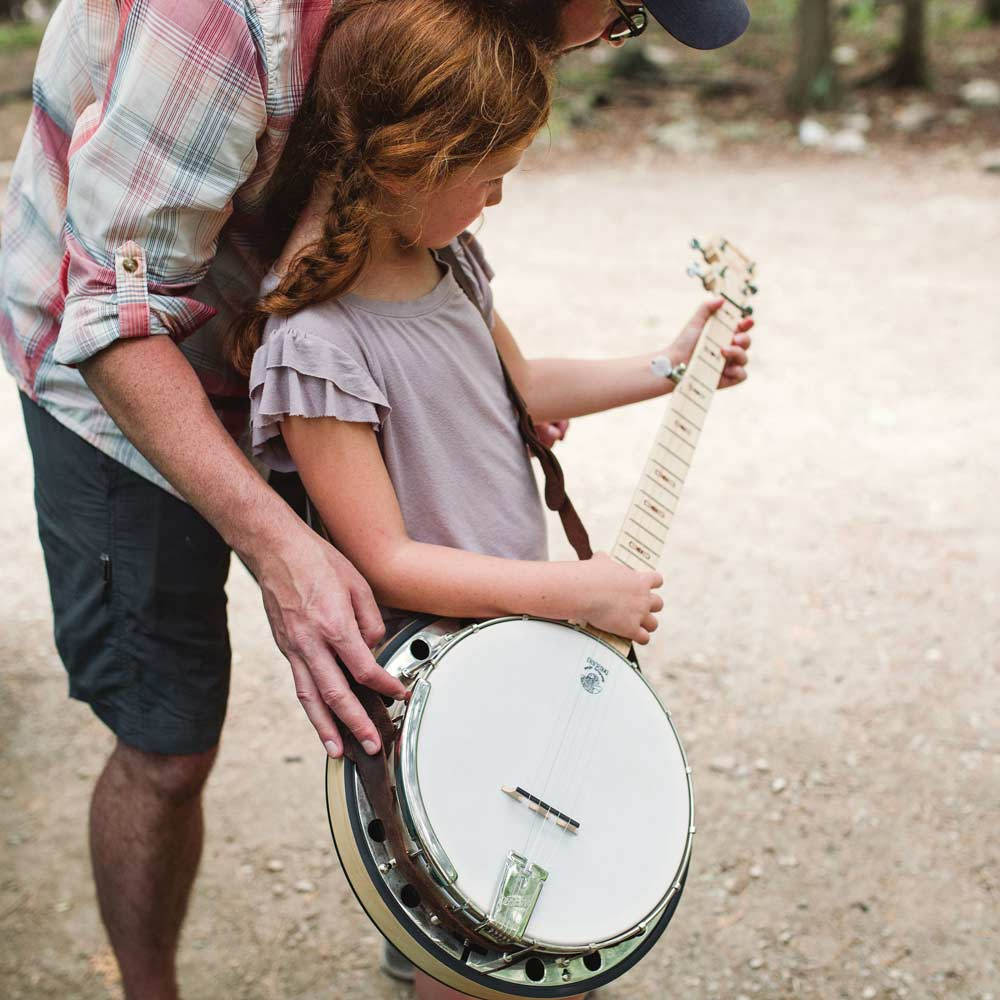 Father and daughter with a Deering Goodtime Two banjo
