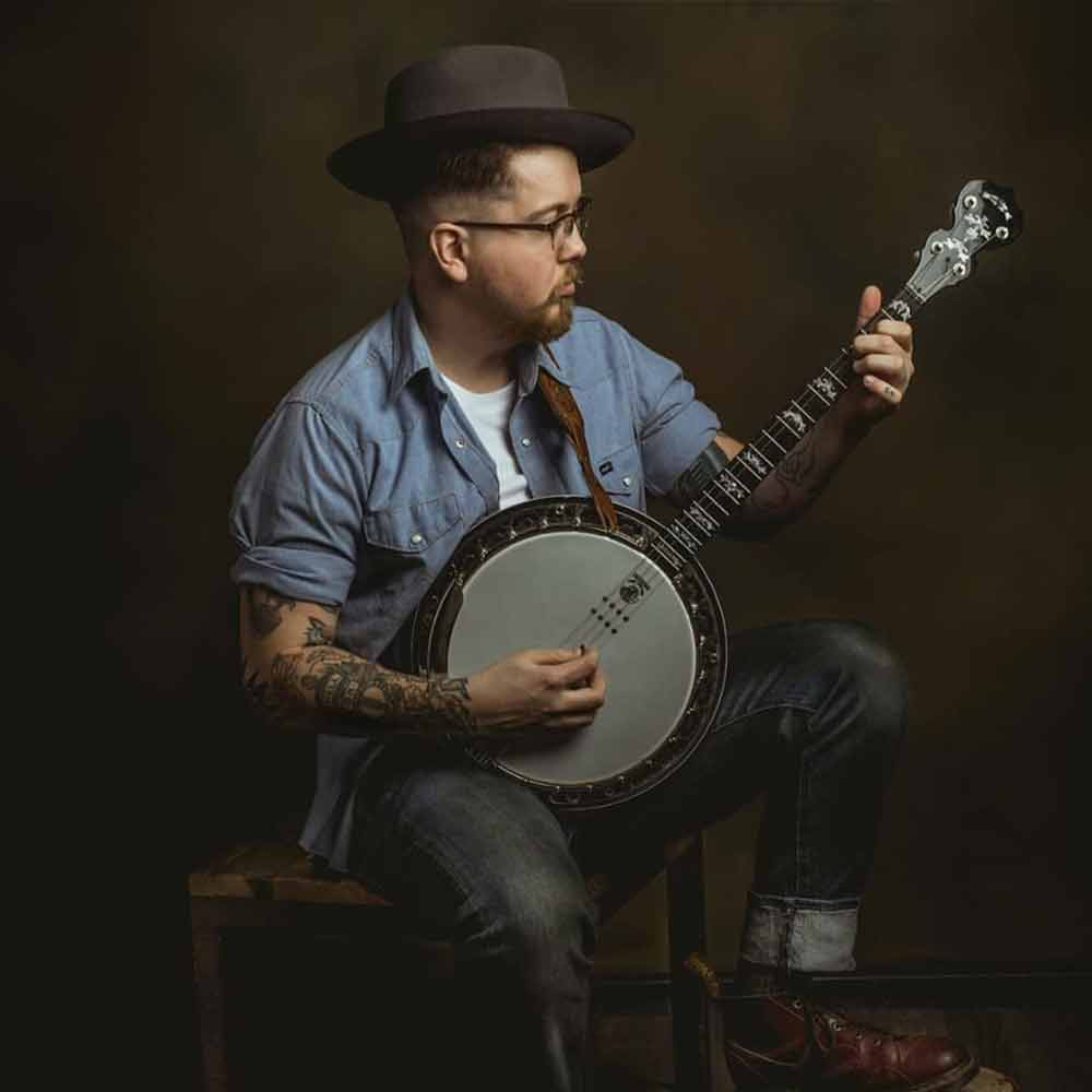 Darren Eedans with his Deering Eagle II 19 Fret Acoustic Electric Tenor Banjo