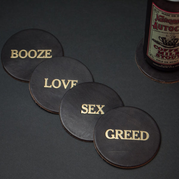 The Lodge Four Vices Leather Coasters at The Lodge