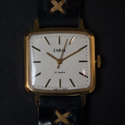 Vintage Zarja Watch Gold with Black Cordovan Leather Strap at The Lodge