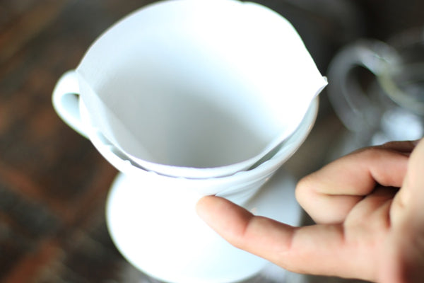 Step 2: Fold Hario V60 filter on the perforated edge and place in the Hario V60.
