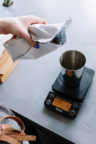 Measuring coffee on digital scale