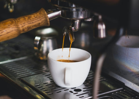 Pulling a double shot of espresso