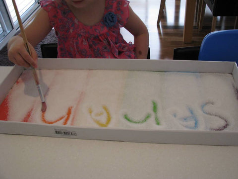 Salt tray sensory bin for children and individuals with autism