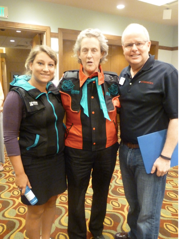 Temple Grandin in her personalized Snug Vest with founder Lisa Fraser and Kevin Custer, board member of the Autism Society of America