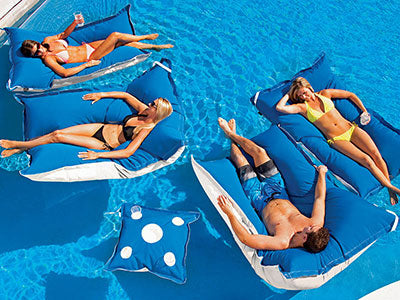 group of people in a luxury pool on floating luxuries pool floats