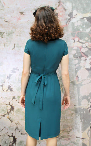 Corina dress in emerald moss crepe - back model shot