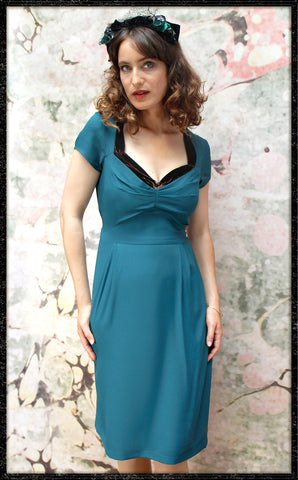 Corina dress in emerald moss crepe - framed model shot