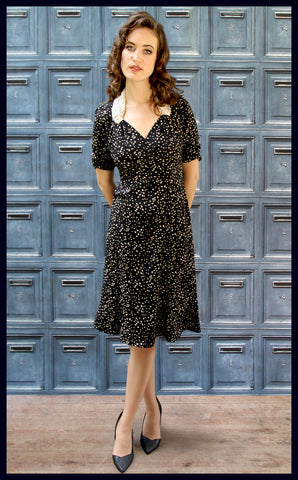 Nancy Mac vintage style moss crepe Eliza dress in black heart print - model shot