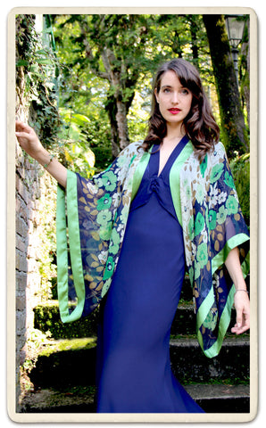 Shrug in green fleur print silk - location shot