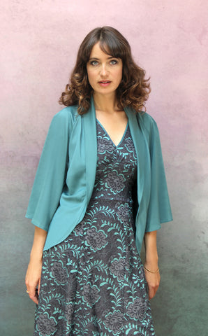 Kristen dress in teal and gunmetal Baroque lace - model shot with Estelle jacket