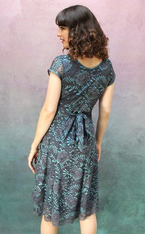 Kristen dress in teal and gunmetal Baroque lace - back model shot