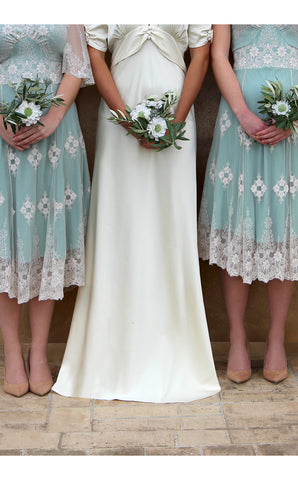 Bridesmaids dresses in ivory and reef