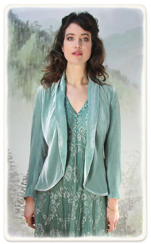 Nancy Mac Valeria dress in aqua shimmer lace - model shot with Rosa jacket in seafoam