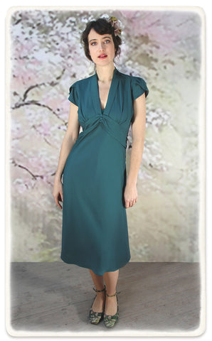 Nancy Mac Sable long-sleeve dress in emerald crepe - model shot