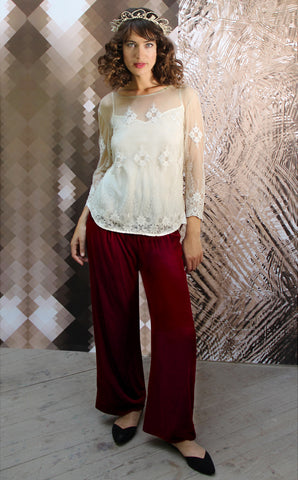 Palazzo trousers in deep red silk velvet - model shot