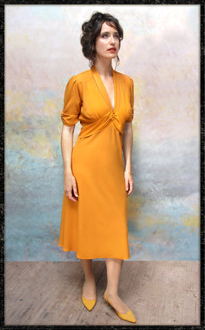 Sable dress in saffron moss crepe - framed model shot