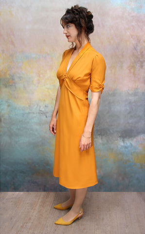 Sable dress in saffron moss crepe - side model shot