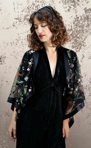 Shrug in black meadow-flower embroidered lace - model shot