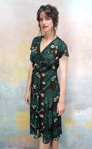 Valeria dress in emerald embroidered pine lace - side model shot