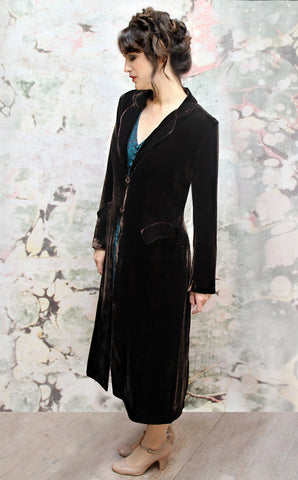 Vivienne coat in chocolate silk velvet - model side