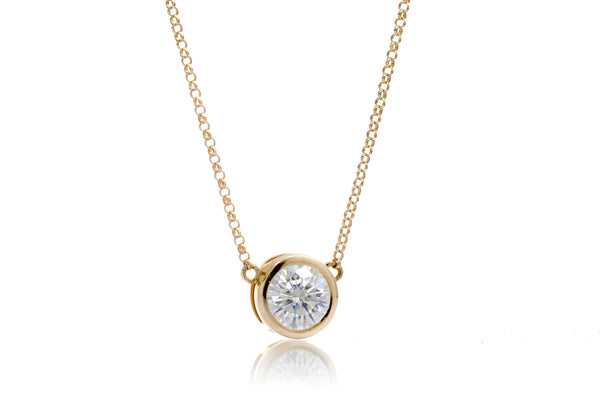 Solitaire bezel round moissanite pendant necklace 6.5mm in yellow gold