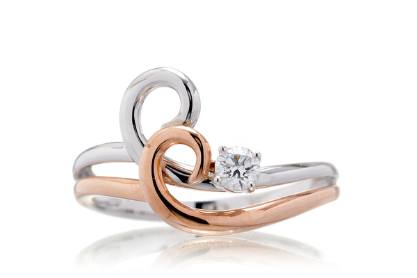 Surfing wave diamond two tone ring white and rose gold